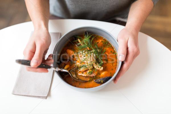 Mujer comer mariscos sopa restaurante de comida nuevos Foto stock © dolgachov