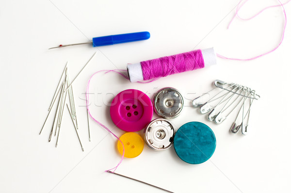 sewing buttons, needles, pins and thread spool Stock photo © dolgachov