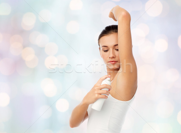 woman with antiperspirant deodorant over white Stock photo © dolgachov
