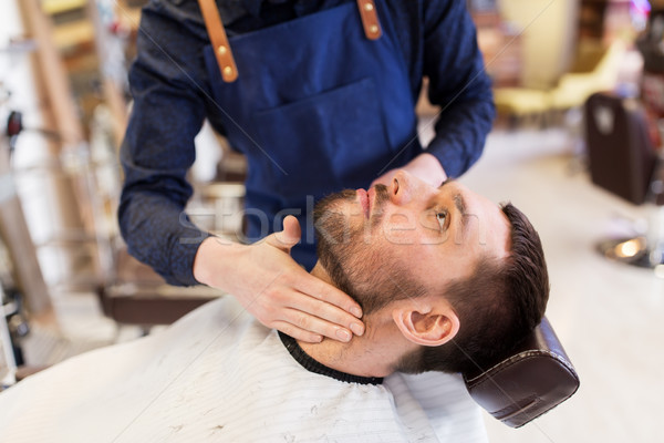 barber applying aftershave lotion to male neck Stock photo © dolgachov