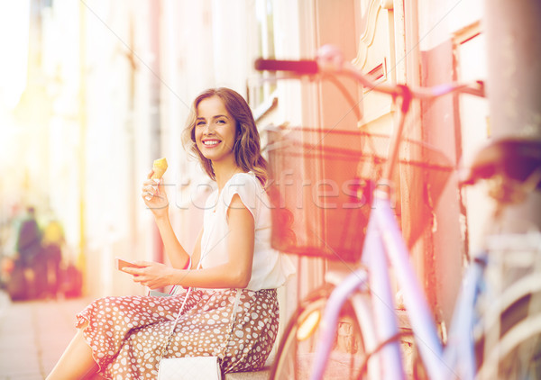 happy woman with smartphone, bike and ice cream Stock photo © dolgachov