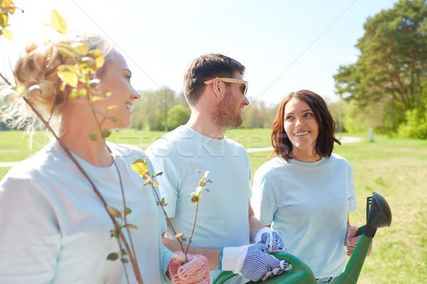 group of volunteers with tree seedlings in park Stock photo © dolgachov