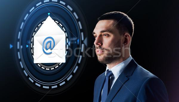 businessman with e-mail message hologram Stock photo © dolgachov