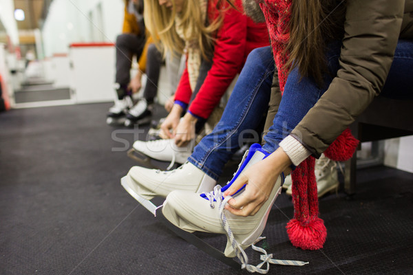 close up of woman putting on ice skates Stock photo © dolgachov