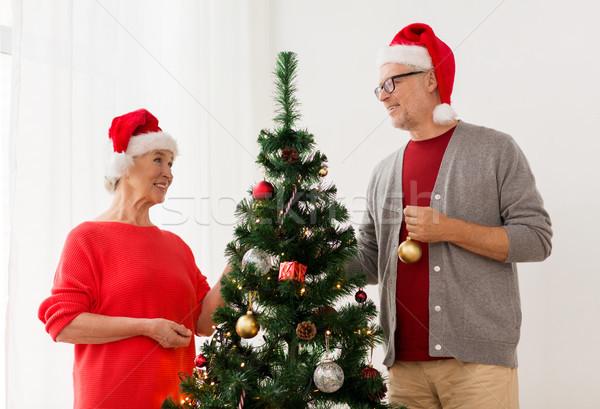 Boldog idős pár karácsonyfa ünnepek emberek mosolyog Stock fotó © dolgachov