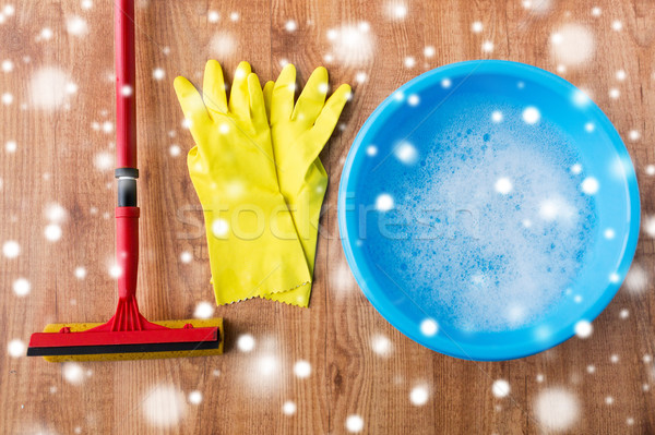 basin with soap water, rubber gloves and squeegee Stock photo © dolgachov