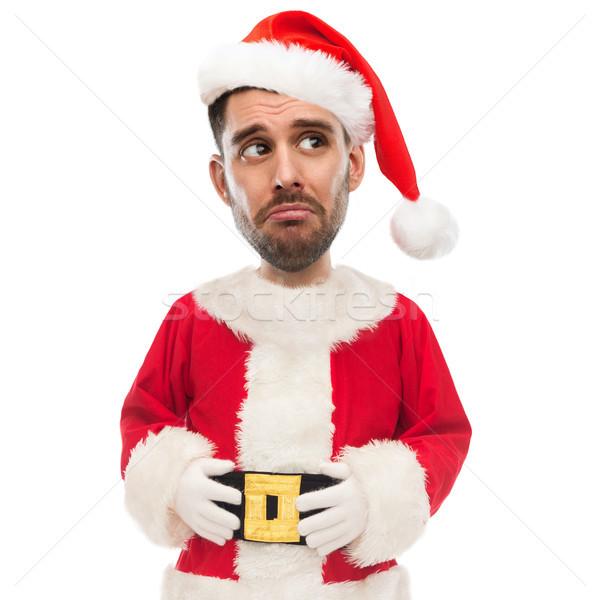 sad unhappy man in santa claus costume Stock photo © dolgachov