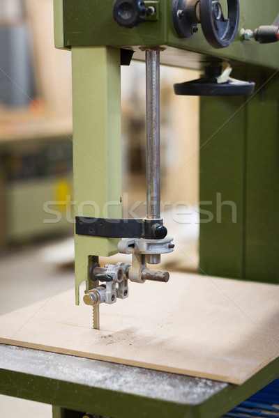 Stock photo: jig saw machine sawing board at workshop