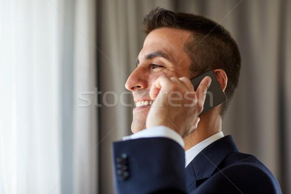 Empresário chamada quarto de hotel pessoas de negócios comunicação Foto stock © dolgachov