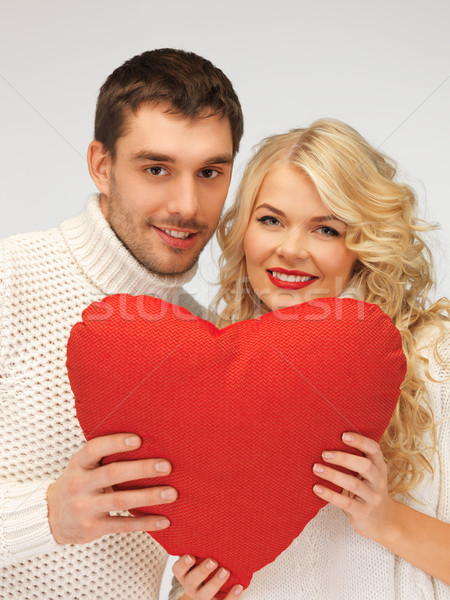 family couple in a sweaters with heart Stock photo © dolgachov