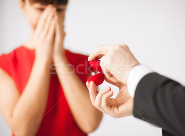 couple with wedding ring and gift box Stock photo © dolgachov
