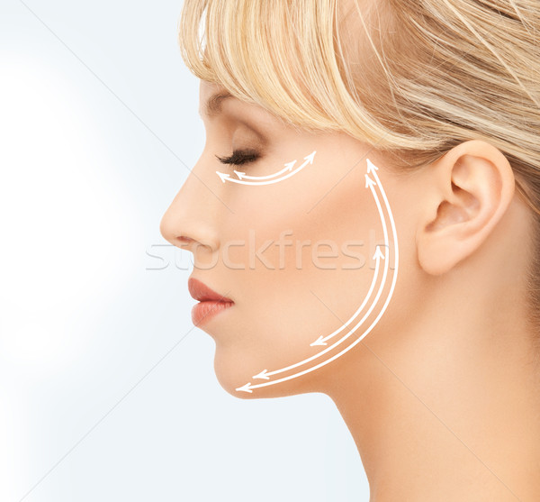 beautiful young woman face with arrows Stock photo © dolgachov