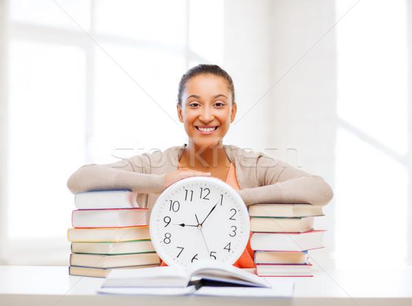 Vonzó nő fehér óra üzlet iroda iskola Stock fotó © dolgachov