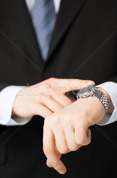 man looking at wristwatch Stock photo © dolgachov