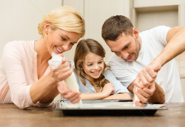 Stock photo: happy family in making cookies at home