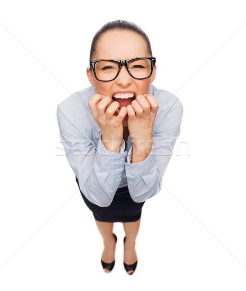Stock photo: frightened businesswoman biting her fingers