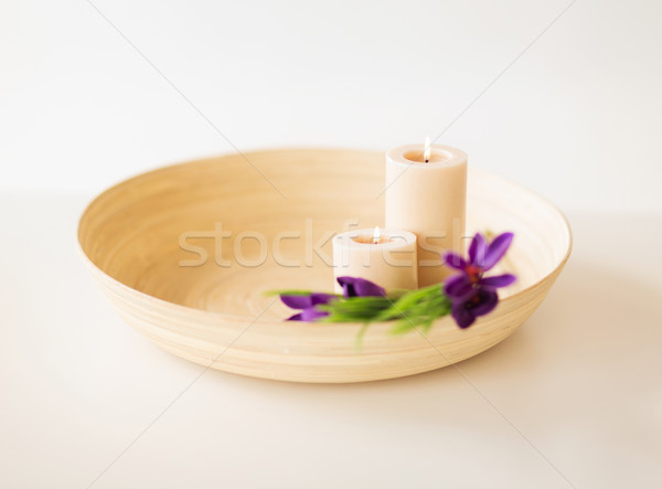 candles and iris flowers in wooden bowel Stock photo © dolgachov