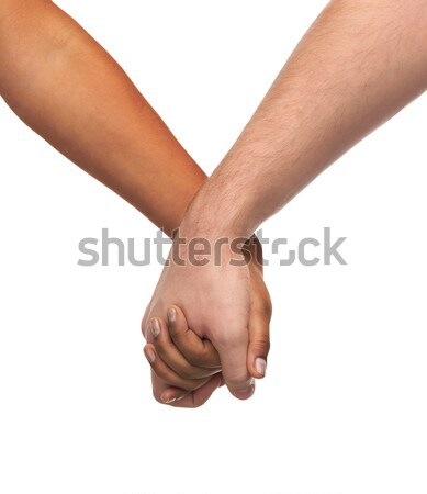 woman and man holding hands Stock photo © dolgachov