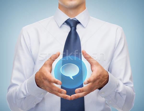 buisnessman holding something in his hands Stock photo © dolgachov