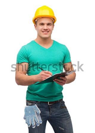 Mosolyog férfi sisak vágólap javítás építkezés Stock fotó © dolgachov