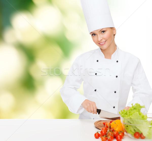 Sonriendo femenino chef cocina alimentos Foto stock © dolgachov