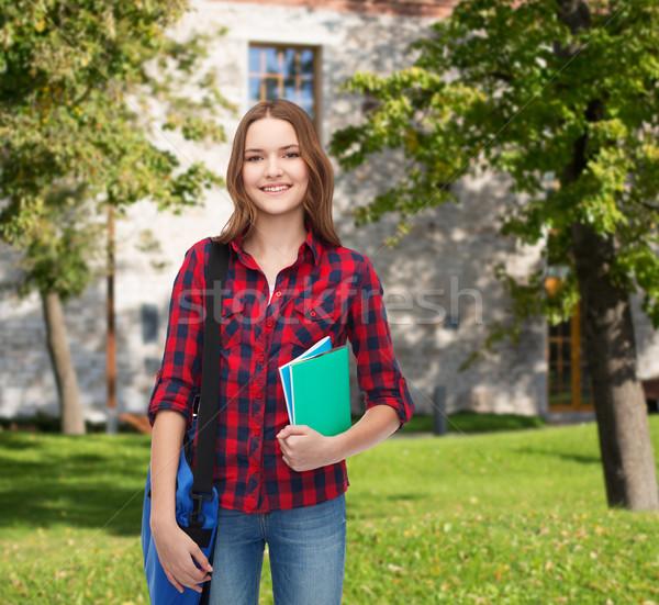 Gülen kadın öğrenci çanta eğitim Stok fotoğraf © dolgachov