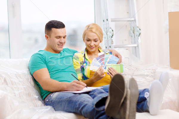 couple looking at color samples in new home Stock photo © dolgachov