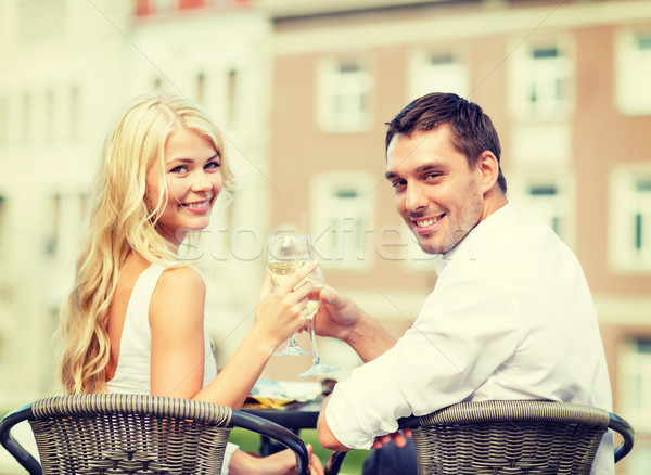 Souriant couple potable vin café été Photo stock © dolgachov