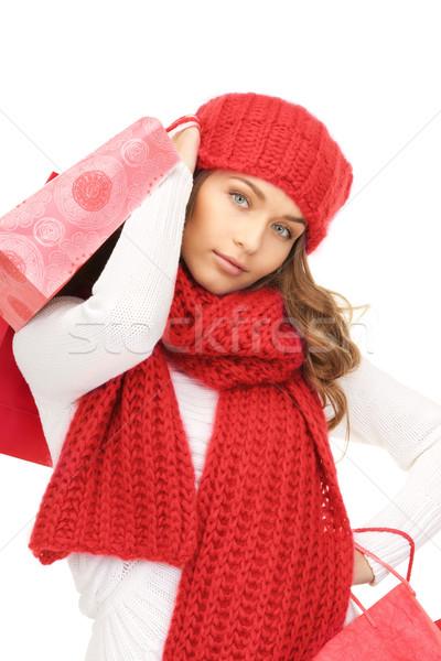 Mosolygó nő tél ruházat bevásárlótáskák boldogság ünnepek Stock fotó © dolgachov