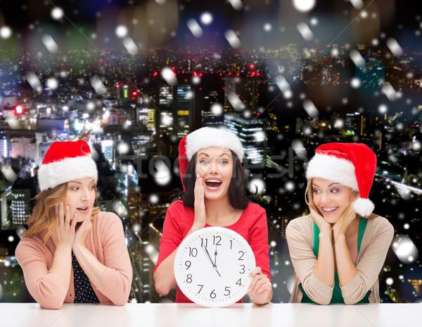 笑みを浮かべて 女性 サンタクロース ヘルパー 帽子 クロック ストックフォト © dolgachov