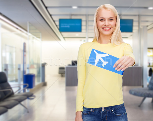 smiling young woman with airplane ticket Stock photo © dolgachov