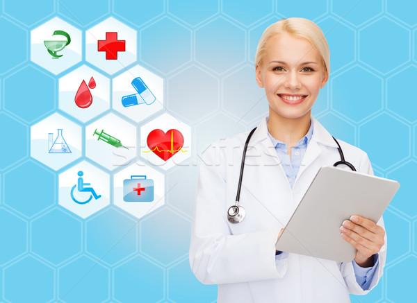 Sorridente médico médico símbolos saúde Foto stock © dolgachov