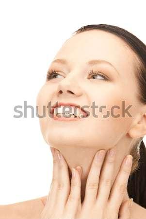 Belle femme pointant menton lumineuses portrait Photo stock © dolgachov