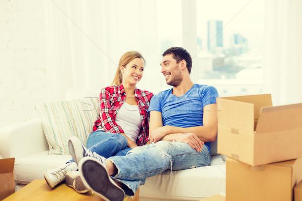 Uśmiechnięty para relaks sofa nowy dom ruchu Zdjęcia stock © dolgachov