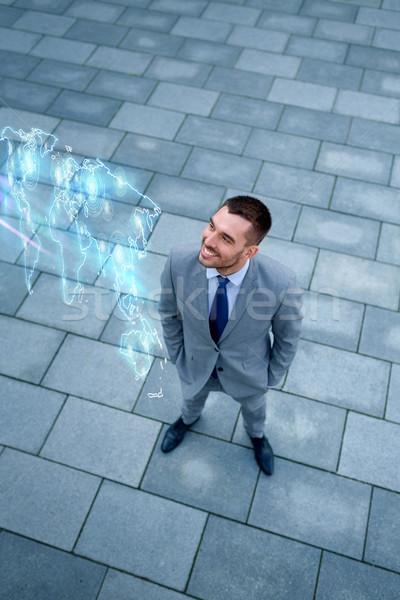 ビジネスマン 世界地図 ホログラム 屋外 ビジネス 開発 ストックフォト © dolgachov