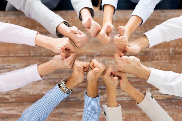 Equipo de negocios gente de negocios gesto trabajo en equipo Foto stock © dolgachov