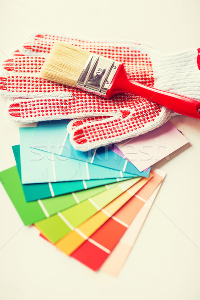 paintbrush, gloves and pantone samplers Stock photo © dolgachov