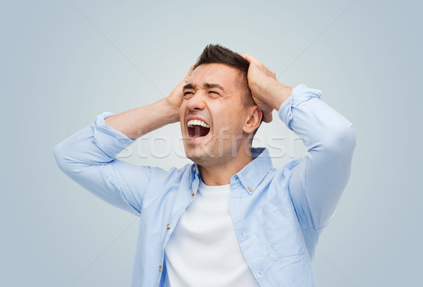 unhappy man with touching his head and screaming Stock photo © dolgachov