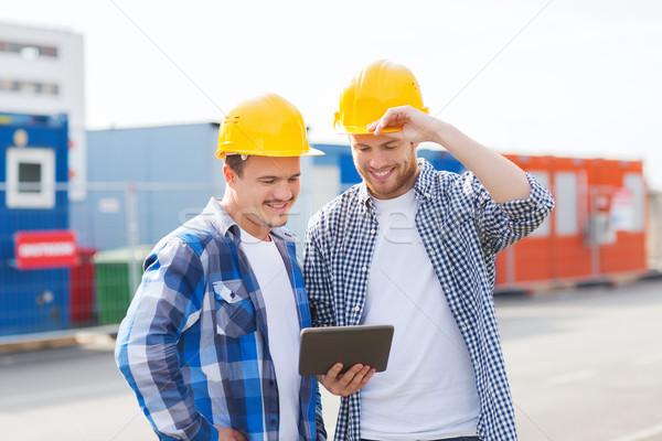 Mosolyog építők táblagép üzlet épület csapatmunka Stock fotó © dolgachov