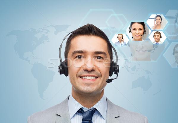 Uśmiechnięty biznesmen zestawu ludzi biznesu technologii komunikacji Zdjęcia stock © dolgachov