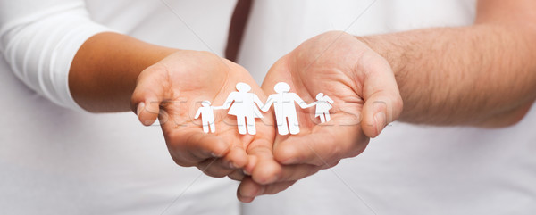 couple hands with paper man family Stock photo © dolgachov