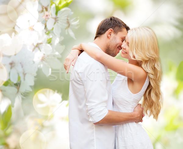 happy couple hugging over blooming summer garden Stock photo © dolgachov