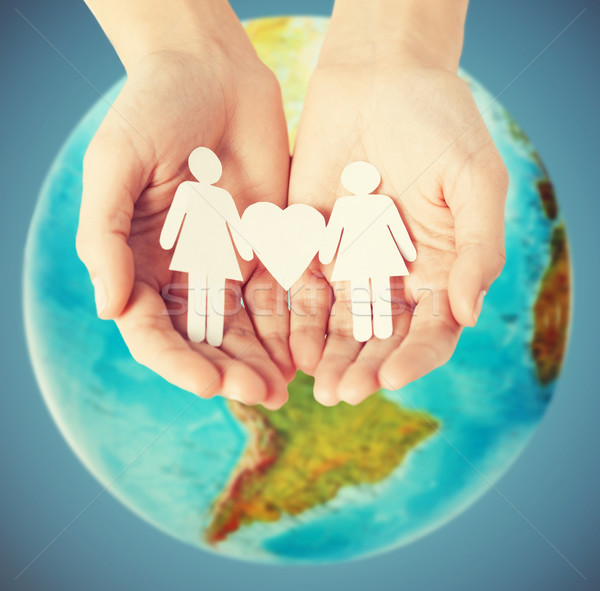 female hands with paper gay couple figures Stock photo © dolgachov