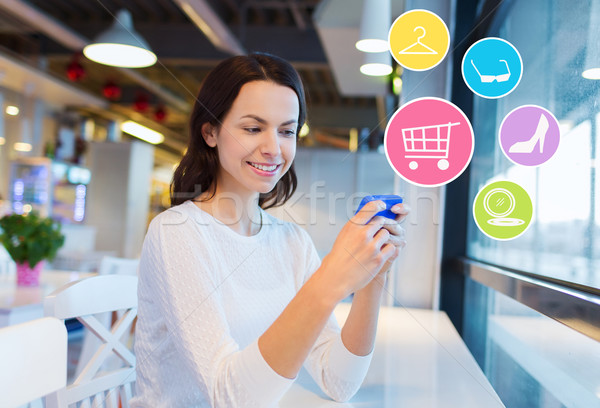 smiling woman with smartphone shopping online Stock photo © dolgachov