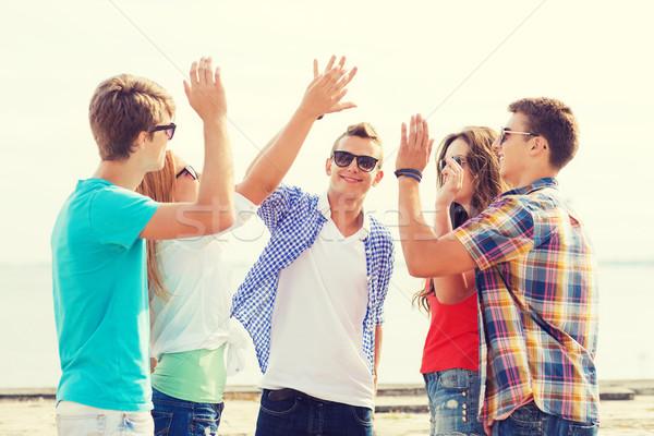 Сток-фото: группа · улыбаясь · друзей · high · five · улице