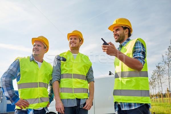 Feliz masculino construtores indústria edifício Foto stock © dolgachov