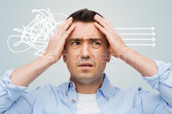 Boldogtalan férfi csukott szemmel megérint homlok stressz Stock fotó © dolgachov