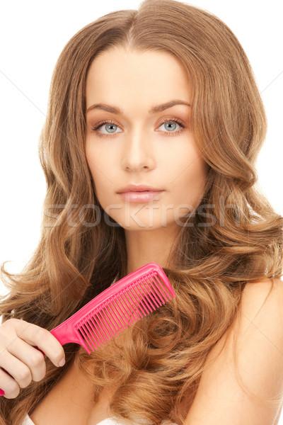 Mooie vrouw kam heldere foto vrouw gezicht Stockfoto © dolgachov