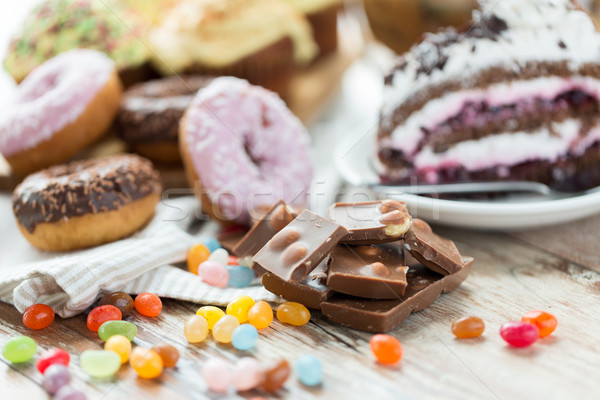 close up of chocolate and sweets on table Stock photo © dolgachov