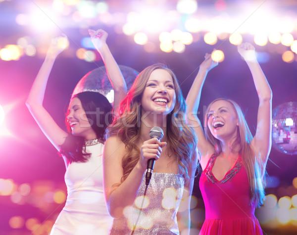 happy women singing karaoke and dancing Stock photo © dolgachov
